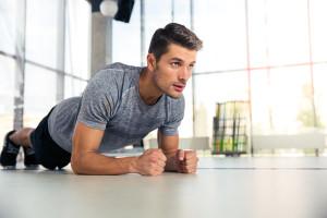 Man in gym gear planking